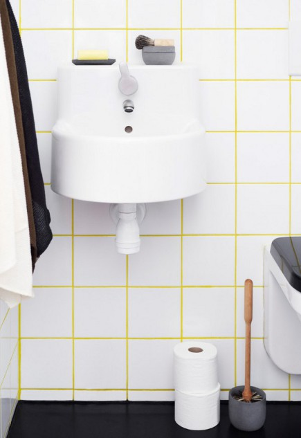 white bathroom tile with yellow grout