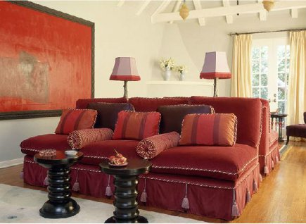 red velvet banquette sofa with cording and tassels