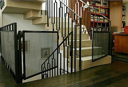 stairway gates - custom iron mesh panel staircase safety gates - HC Metals via Atticmag