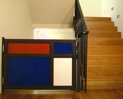 stairway gates - custom color block staircase safety gate - Dijeau Poage Construction via Atticmag