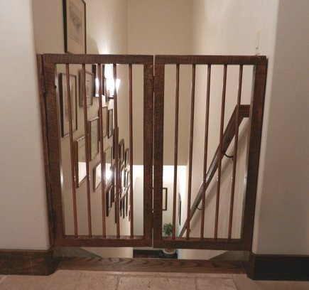 stairway gates - custom salvaged wood and copper piping bifold staircase gate - Atticmag