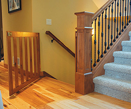 custom wood staircase safety gate via Atticmag