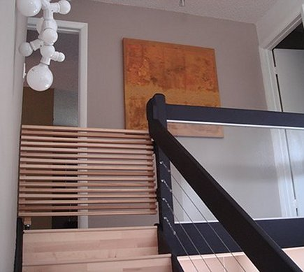 custom modern wood slat staircase safety gate via Atticmag