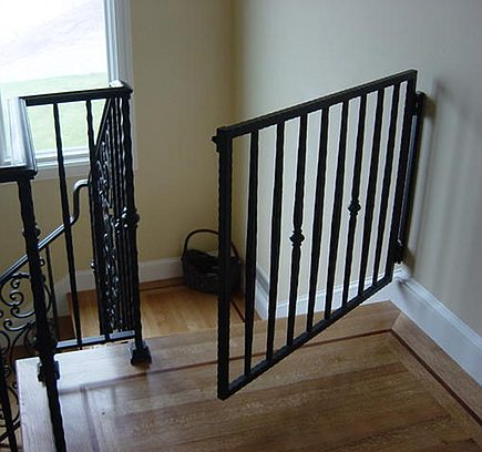 stairway gates - custom wrought iron staircase safety gate - JD Stairs via Atticmag