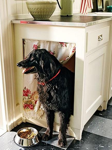 custom base cabinet hidden dog bed area with fabric curtain via Atticmag