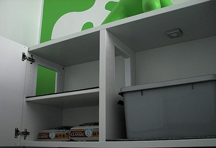 cat litter box hidden inside base cabinets via Atticmag