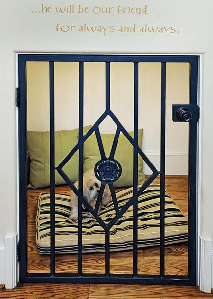 under the stairs dog bed den with custom iron gate door via Atticmag