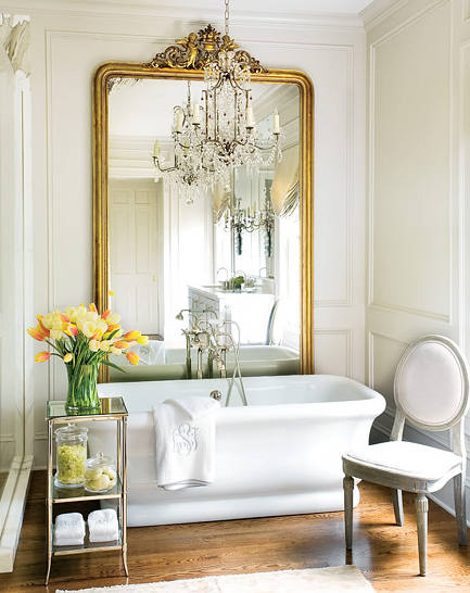 over sized gold leaf French mirror behind tub
