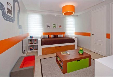 toddler's room- mid-20th century style kids room with colorful wall graphics - Kleppinger Design Group