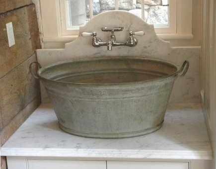 custom laundry room - washtub basin sink with a marble counter and backsplash - salisbury artisans via atticmag