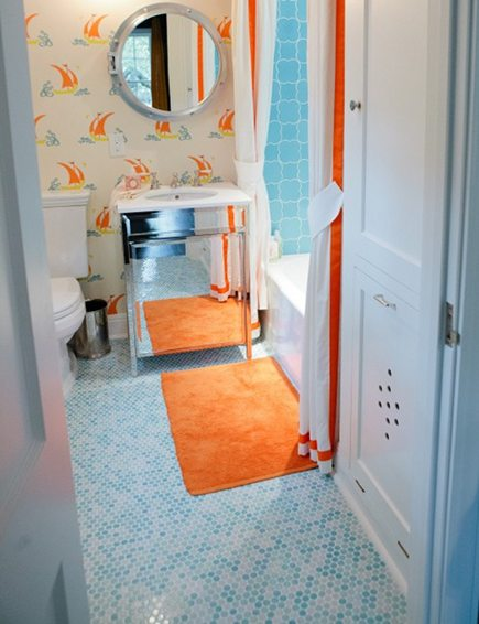 colorful orange and blue guest bath by Baily McCarthy