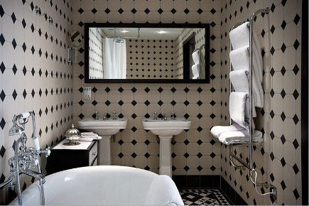 black and white Art Deco pattern tile bathroom with pedestal sinks