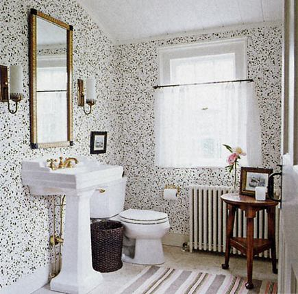 cottage bathroom with black and white overall wall pattern and black accents