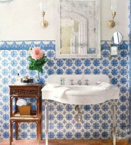 blue and white Lascaux Portuguese tiles in a bathroom by Michael S Smith