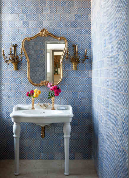 geometric blue and white tiles on bathroom walls