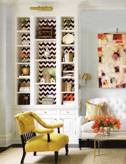 Hand painted black and white zig-zag pattern behind bookshelves