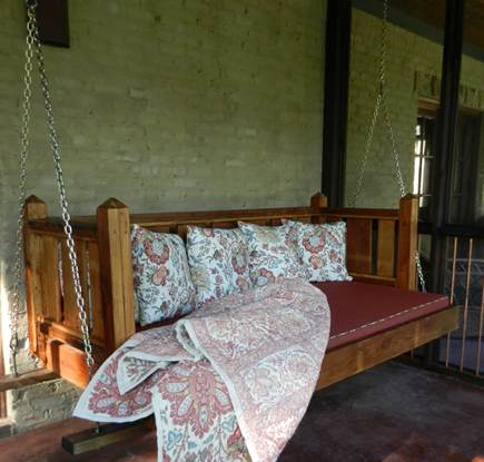 custom salvaged pine swinging porch bed