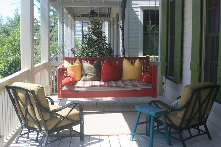 red painted custom swinging porch bed from Simply Seleta