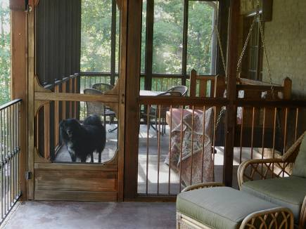 screened in porch with custom swinging porch bed