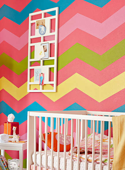 nursery wall designs - custom hand painted multicolor chevron nursery wall - Lowes via Atticmag