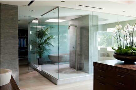 Floor to ceiling glass panels create a master bath wet room oasis from Elle Decor