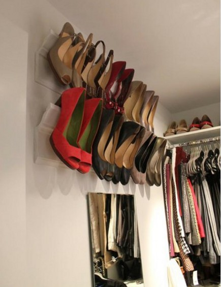shoe closet - crown molding and baseboard made into shoe closet rails for stilettos - via Atticmag