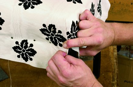 tacking fabric to the front of a chair from The Upholsterer's Handbook