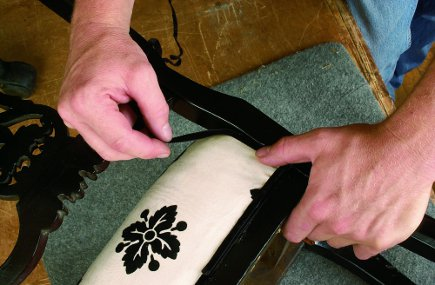 attaching trim to a newly upholstered chair from The Upholsterer's Handbook