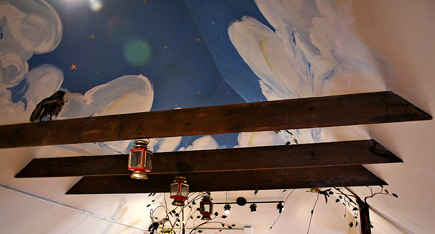 attic ceiling painted with night sky stars and clouds