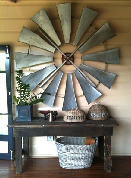 vintage windmill wheel hanging on wall