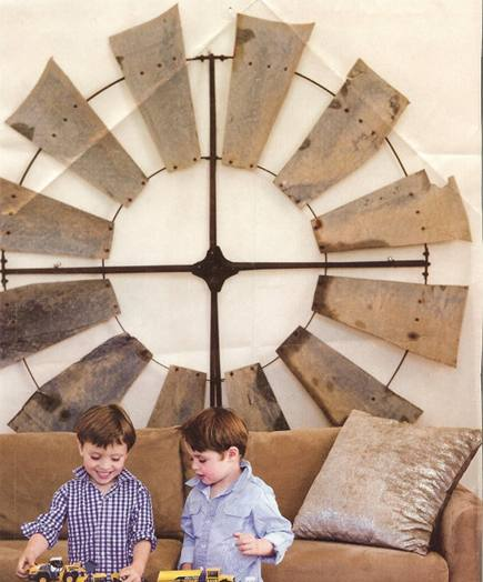vintage wooden windmill wheel hanging above sofa