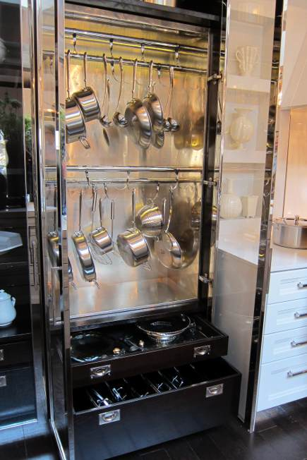 stainless and glass metal boy hanging pot cabinet in Mick De Giulio's Kitchen of the Year for House Beautiful