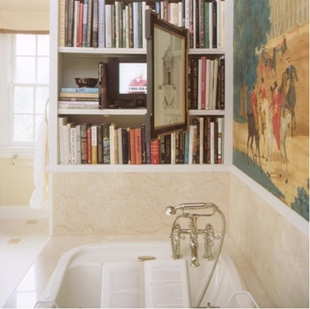 bookcase at end of bathroom with concealed television