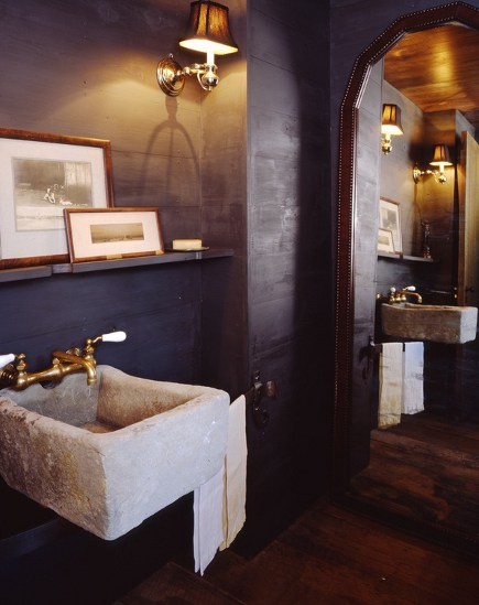 antique weathered marble basin sink in powder room