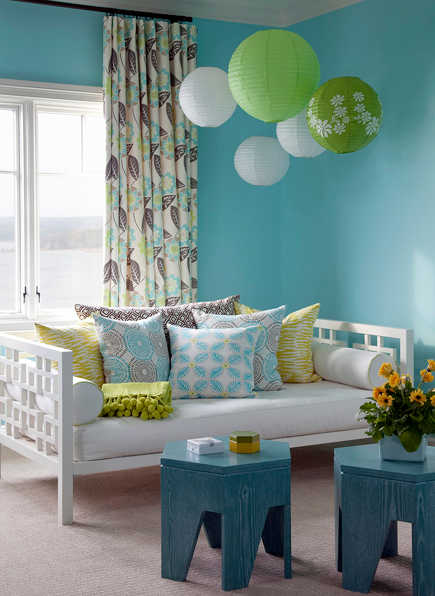 blue and green bedrooms - vibrant blue and green bedroom with day bed by Bear-Hill Interiors via Atticmag