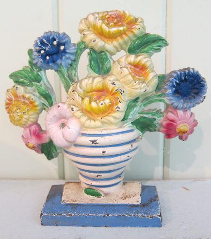 Hubley cast iron marigolds doorstop with blue and white striped vase, number 315