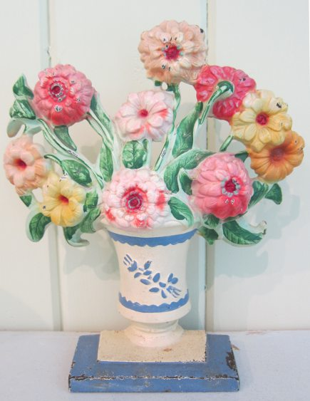 Hubley cast iron zinnias doorstop with blue and white base, number 316