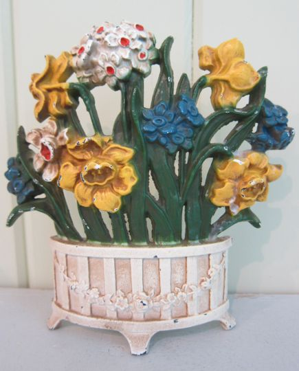 John Wright spring flowers cast iron doorstop with garland-decorated vase