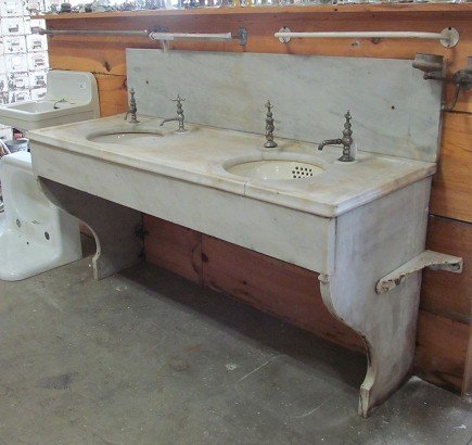 vintage double marble sink with legs and backsplash