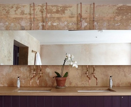 exposed copper plumbing design - copper piping bathroom sink faucets - Archangel Hotel via Atticmag