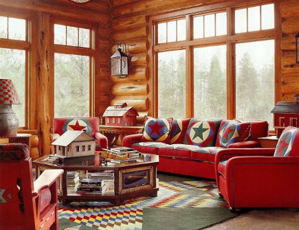 Idaho timber vacation home with red, green and blue winter theme decor