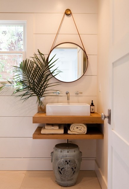 vessel sink installed on an oak slab in a powder room