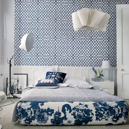 The right geometric prints on wallpaper and fabric can act as modernizers  in blue and white bedrooms.