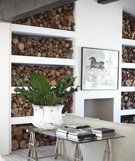 firewood storage - modern living room with firewood shelves flanking the hearth - style files via atticmag