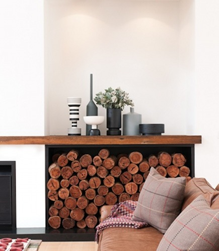 living room firewood storage niche with wood display shelf