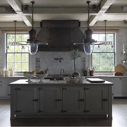 tone-on-tone gray industrial style kitchen by Steven Gambrel