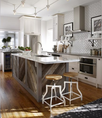 kitchen with diagonal weathered gray barnwood paneling on the island