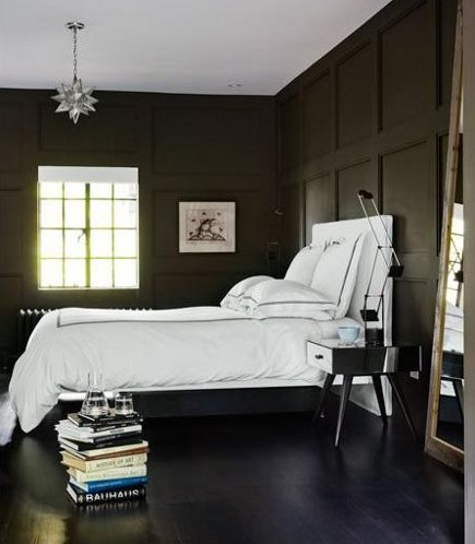 Bedroom with wood-paneled walls painted charcoal gray