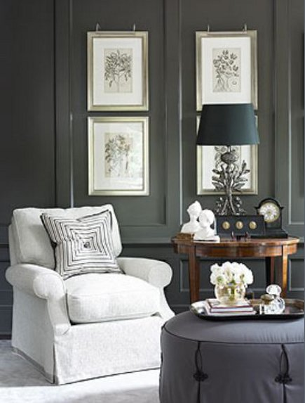 close up of medium dark gray walls with white upholstery and art