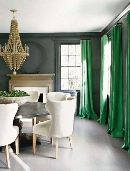 deep gray dining room with white ceiling, floor and upholstery plus shamrock green curtains.